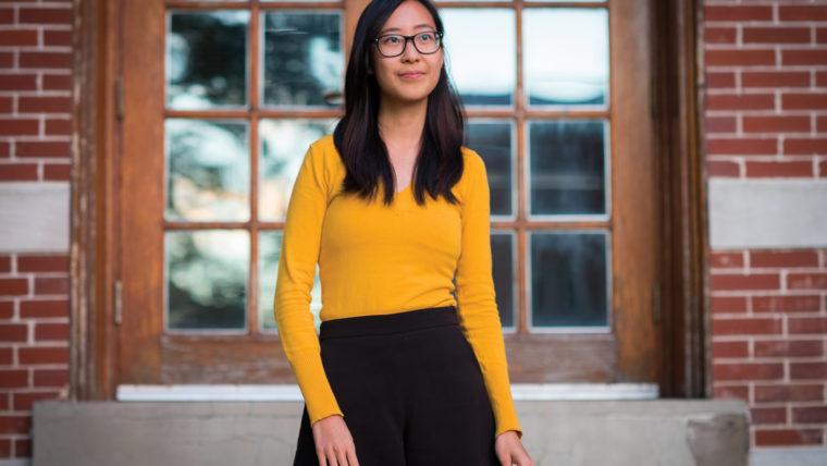 Ashley Yong portrait wearing a gold sweater