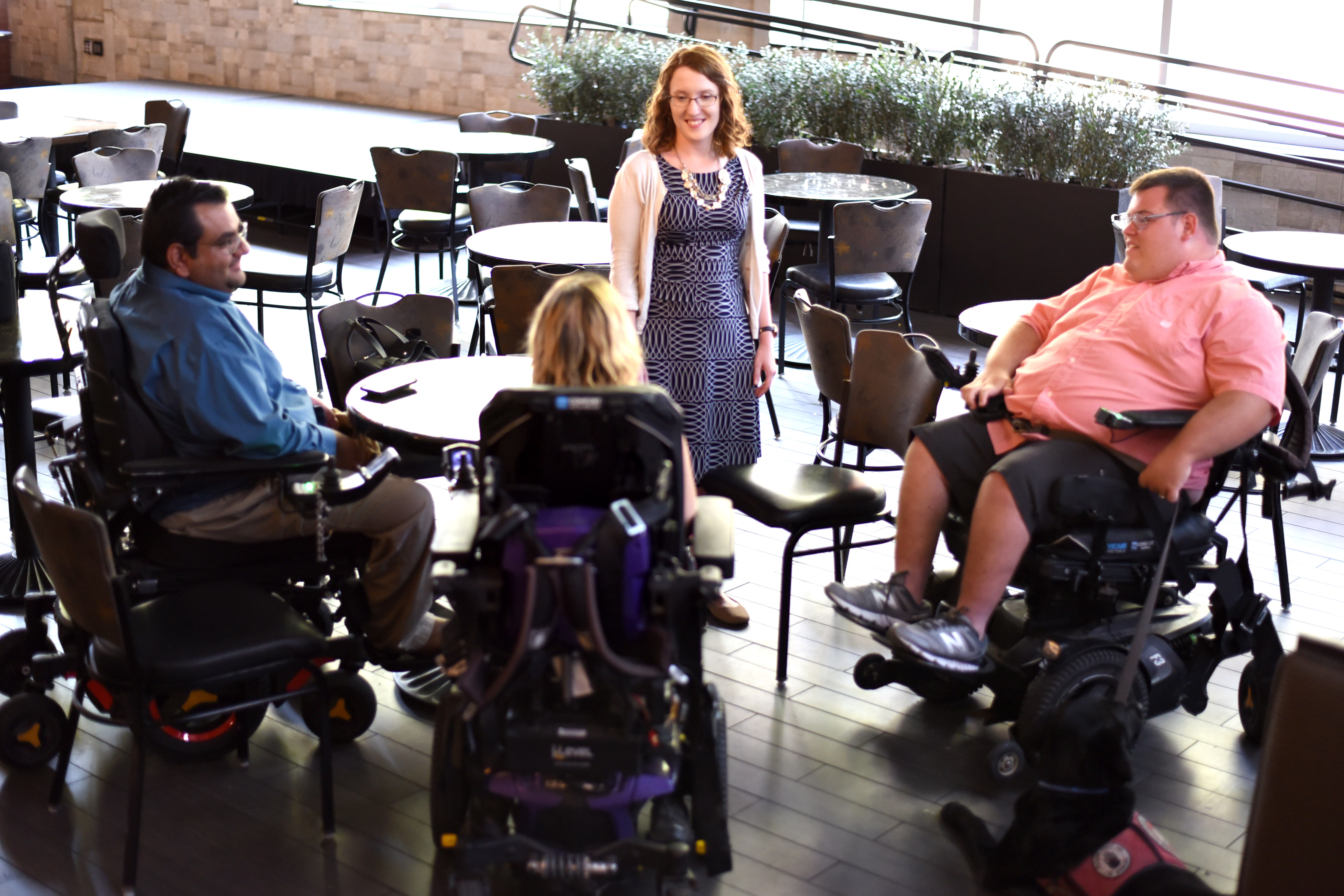Members of the Accessibility and ADA staff interact with people who use wheelchairs in the Shack of the MU Student Center.