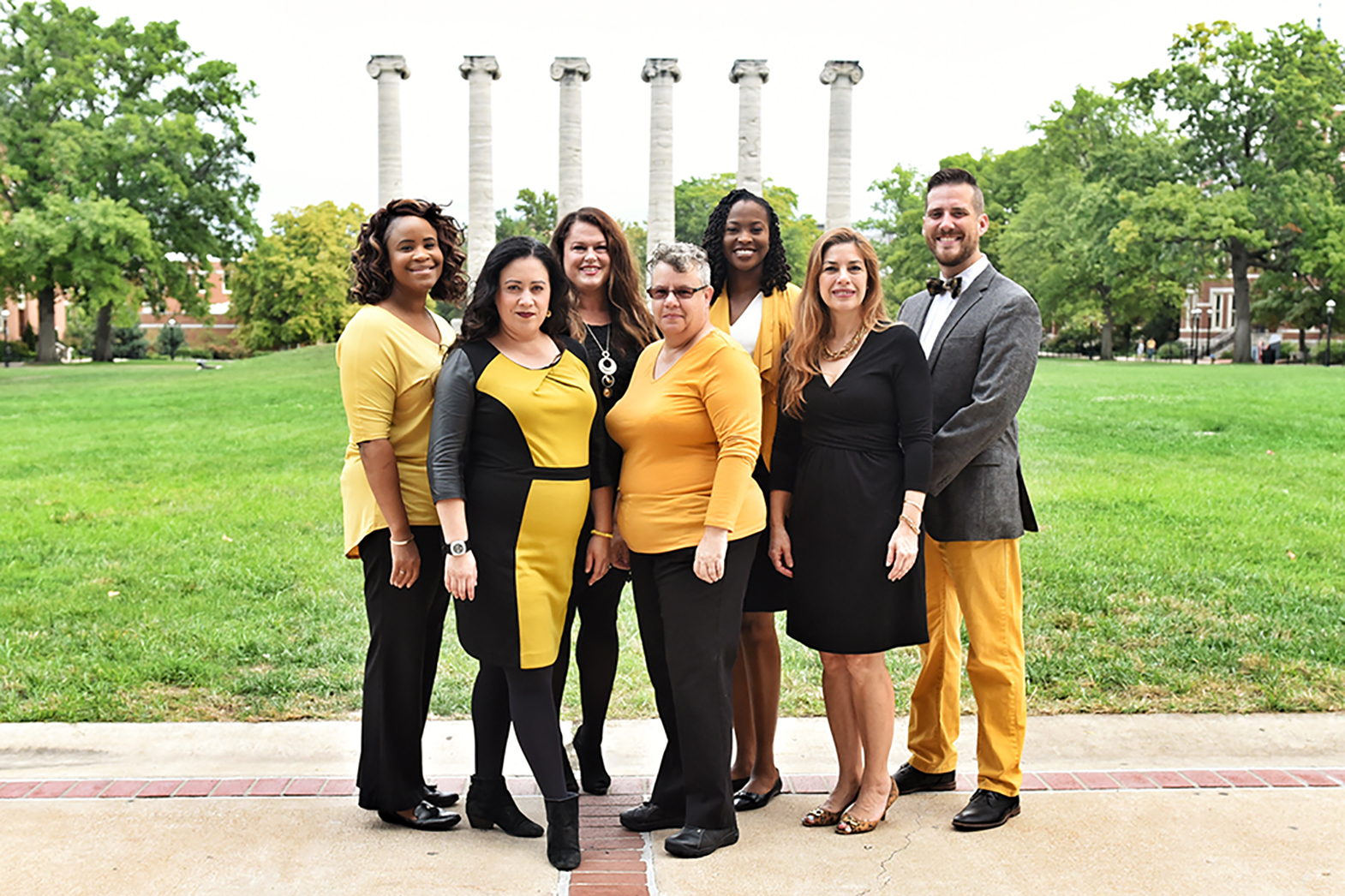 Members of OIE pose together in front of the Columns - Morgan McAboy-Young, Astrid Villamil, Caprcie Leighton, Tara Warne-Griggs, Inya Baiye, Alejandra Gudino, Ryan Gavin