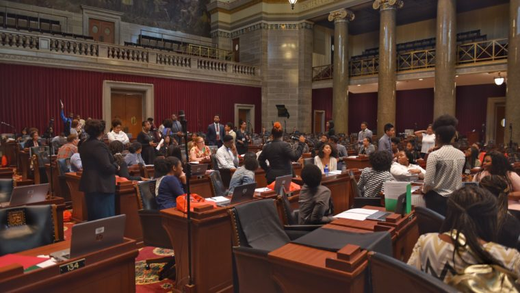 Students work on the floor of the Capitol as part of the Emerging Leaders Conference.