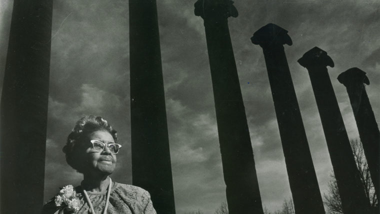 Lucilie Bluford in front of the Columns in a black-and-white photo