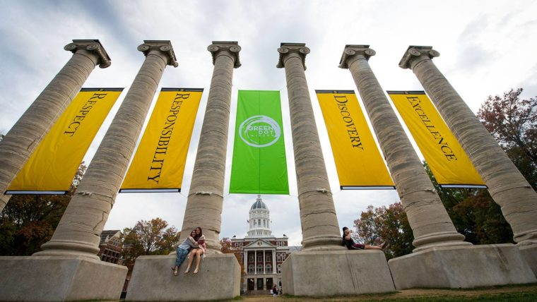 Photo of the Columns with values banners hanging between them and the Green Dot banner in the middle.