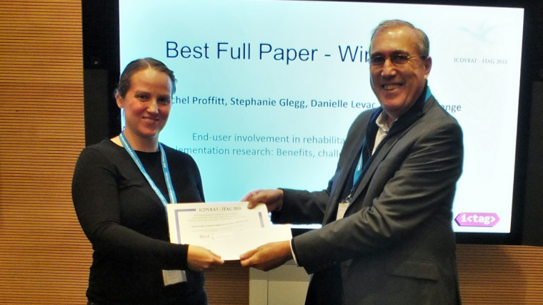 Proffitt winning best paper award and being presented with a certificate