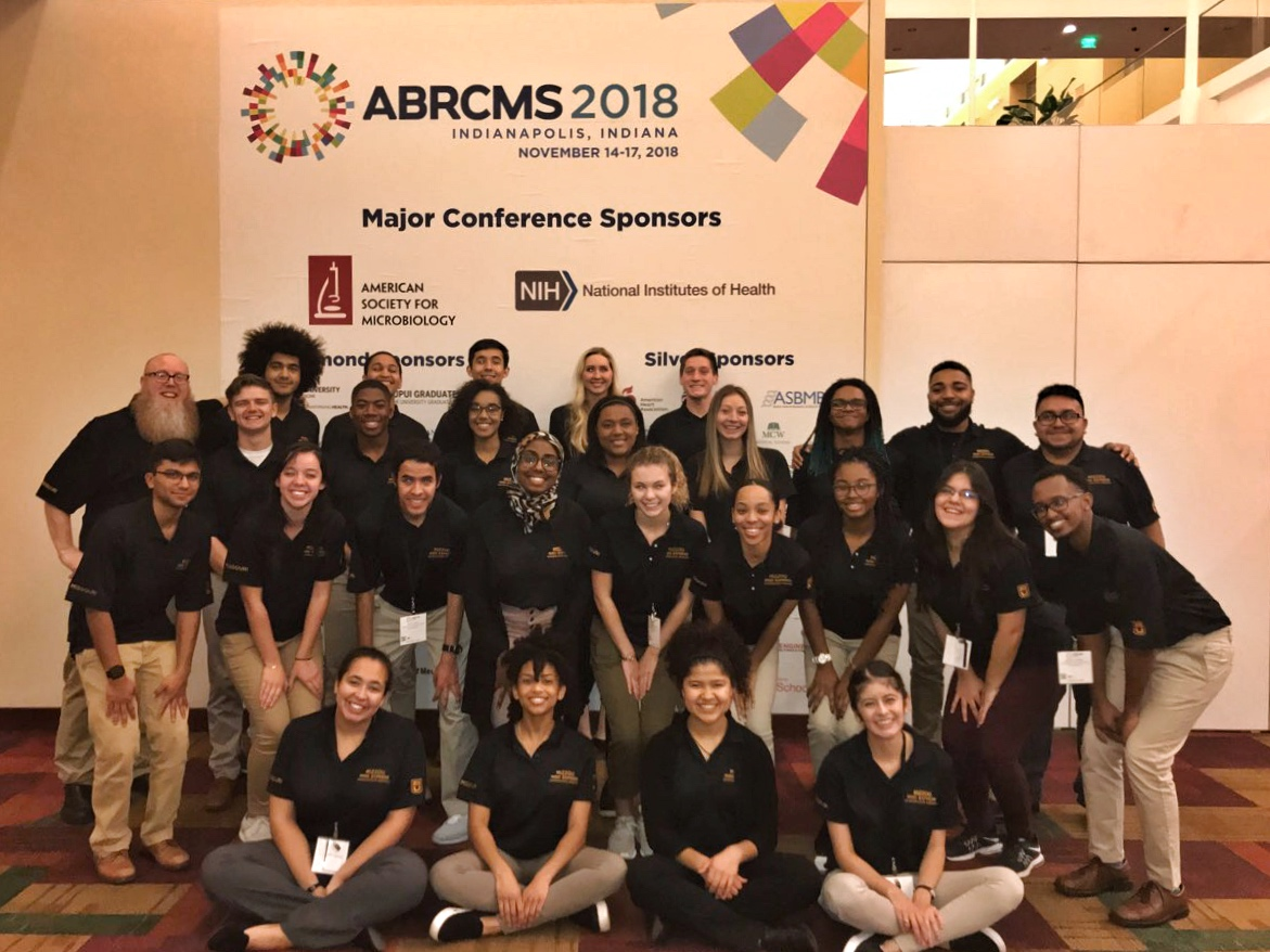 IMSD Scholars pose with Brian Booton at the ABRCMS Conference in Indianapolis.
