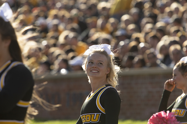 """Davidson cheers for the football, basketball and volleyball teams. """"It's really awesome to we have the opportunity to"""" cheer at a bowl game, she says. The Tigers should learn their bowl destination Dec. 2. Photo by Sam O'Keefe"""