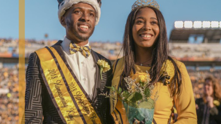 Tyler Brumfield and Jalyn Johnson awarded Homecoming Royalty 2019. Wearing black and gold formal wear on Faurot Field with crowns.