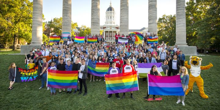 Large LGBTQ group gathered on the Quad for a Pride photo