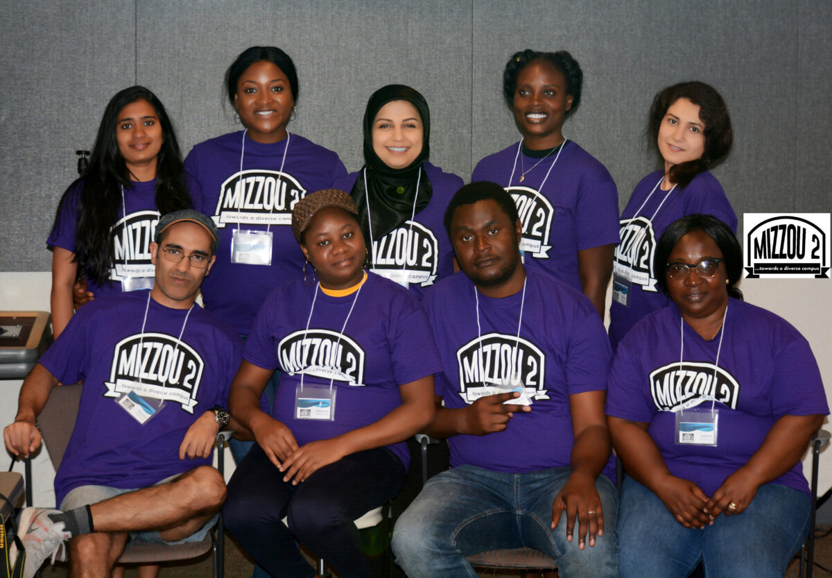 Group photo of 9 Mizzou 2 participants wearing purple shirts.