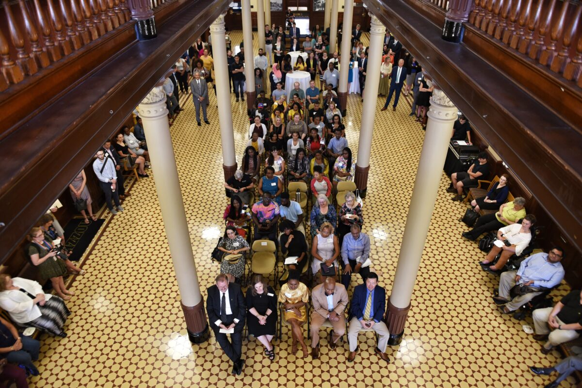 The crowd for the farewell fills the first floor of Jesse Hall's rotunda.