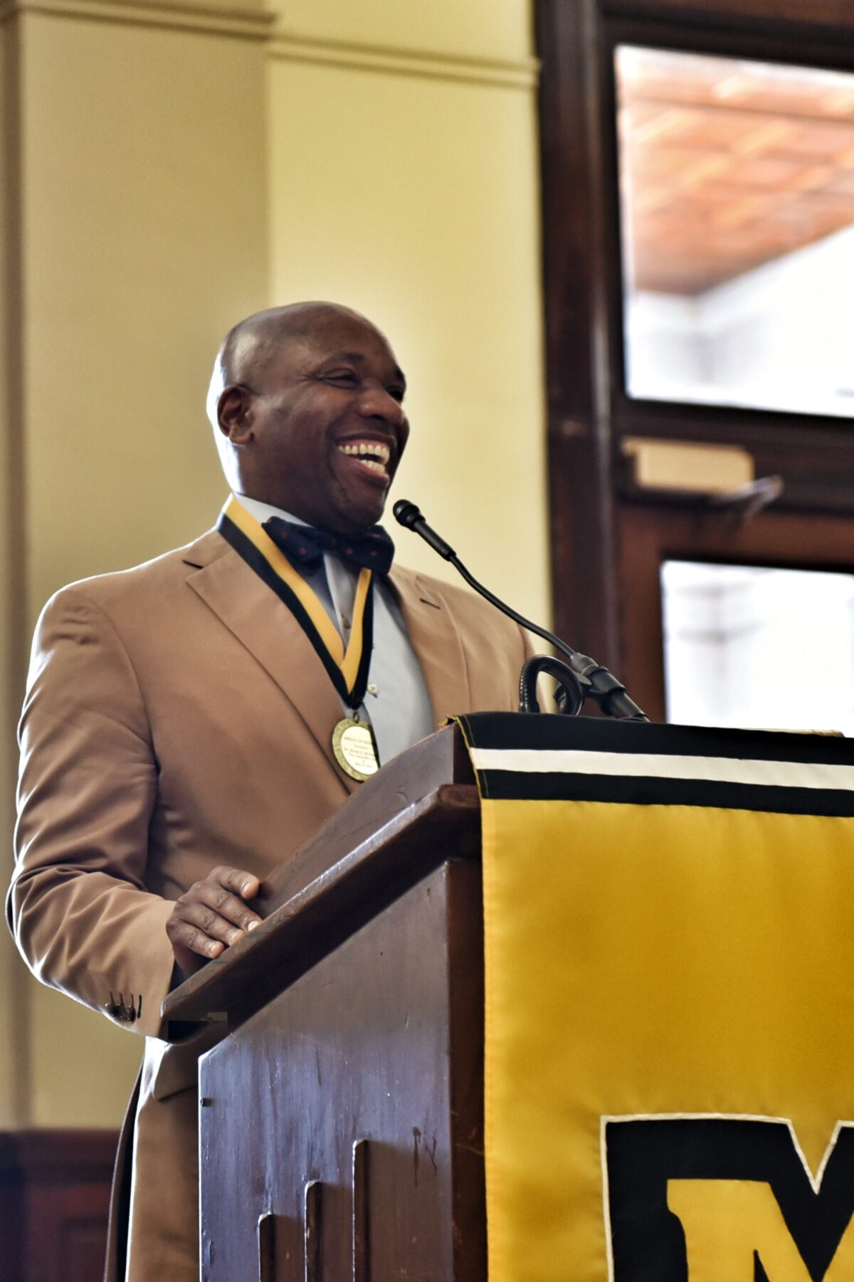 McDonald shares a laugh with the audience during his speech.