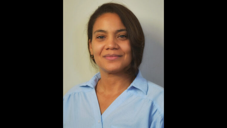 Wide headshot of Dr. NaTashua Davis in a blue shirt