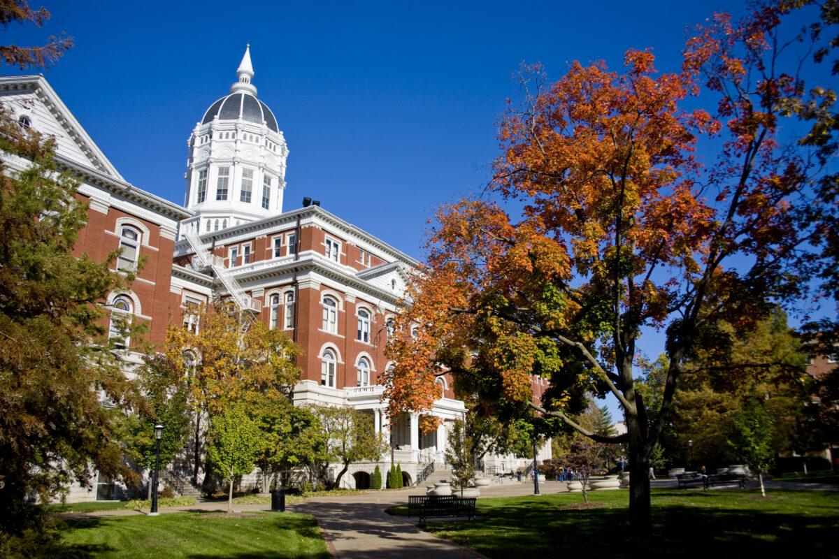 Image of Jesse Hall with trees in fall foliage.