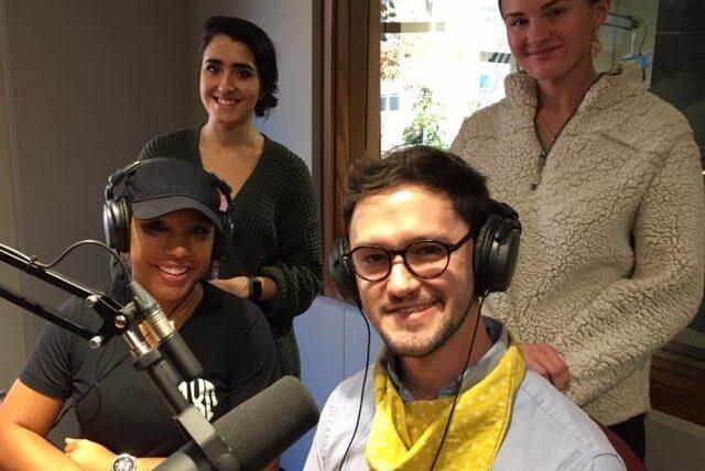 Four people in the KBIA studio around the mic.