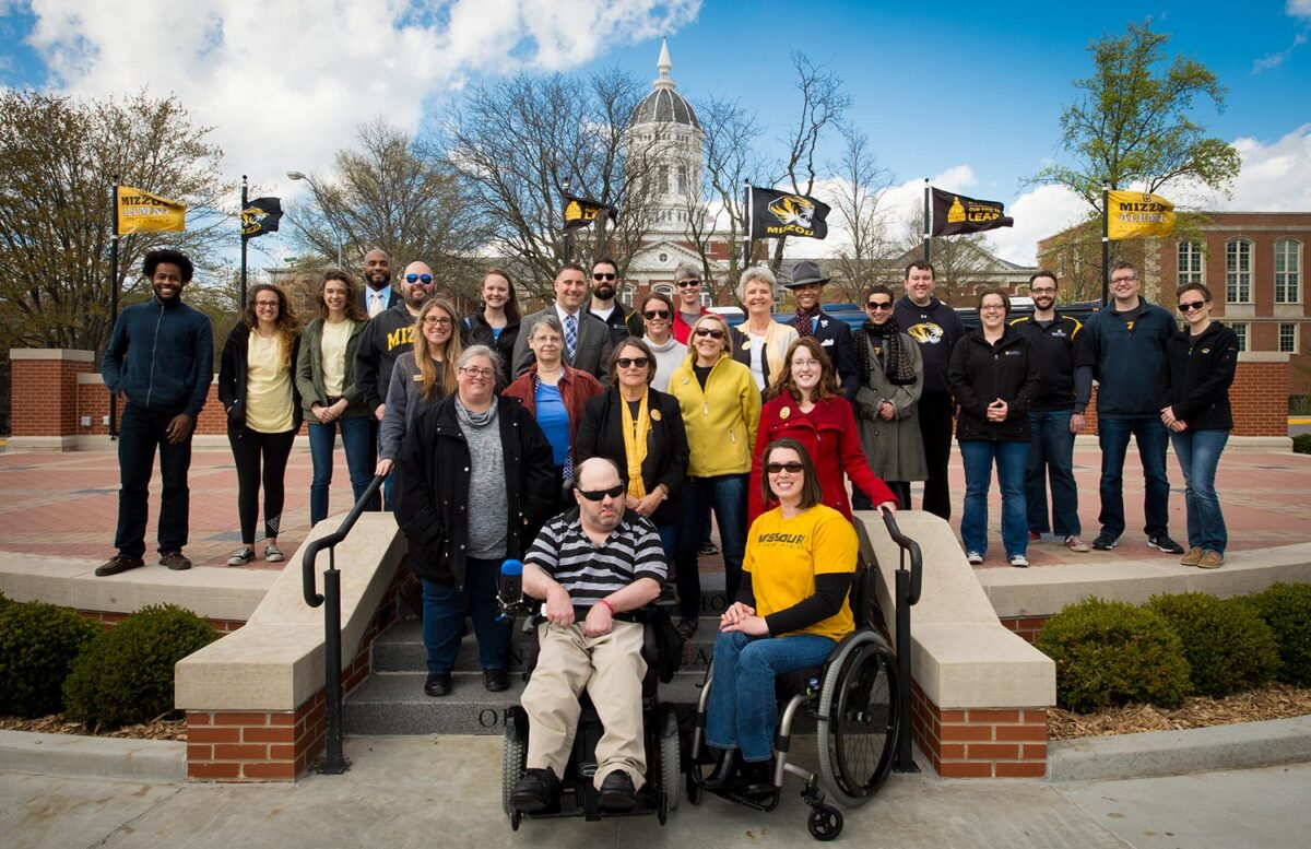 Allies for Access photo on Traditions Plaza. People using wheelchairs and on stage.