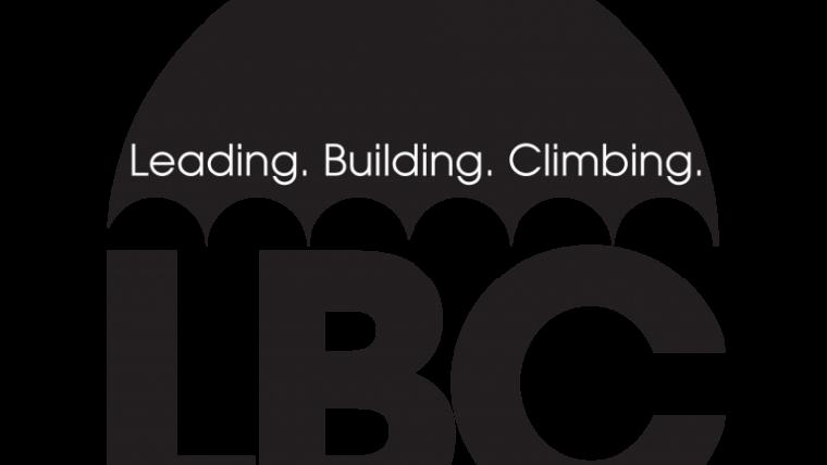 """LBC umbrella logo. """"Leading. Building. Climbing."""" on a black umbrella."""