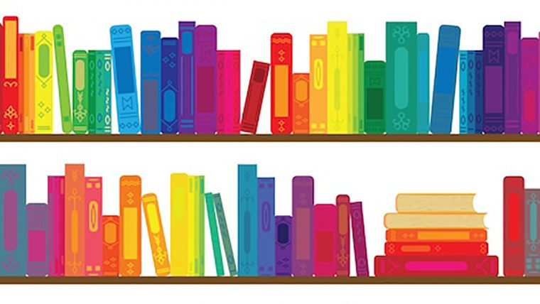 Two shelves of rainbow-colored books