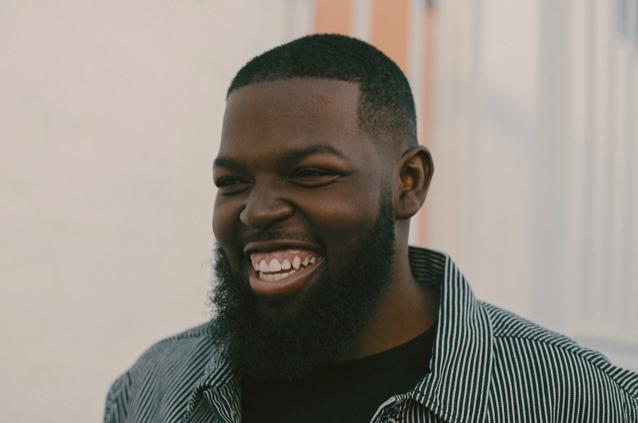 Headshot of Curtis Taylor Jr. smiling