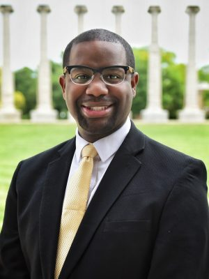 Headshot of Maurice Gipson on the Quad with Columns in the background