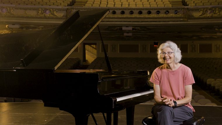 This is a photograph of Lucy Urlacher, a piano tuner.