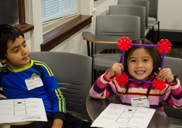 This is an image of two children attending a Stem Cubs event.